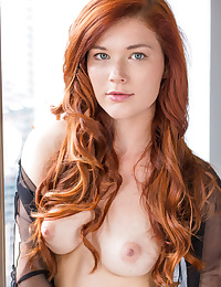 Redhead Mia Sollis, strips her see-through top disclosing her sexy, curvy body and   delectable pussy on burnish apply couch.